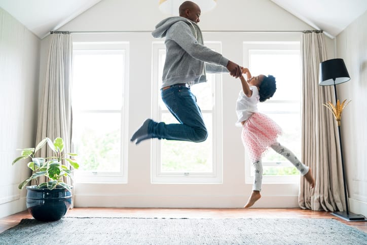 Happy homeowners jumping